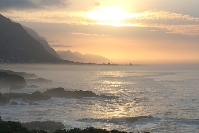 Sunset over Grotto Beach & the Klein River mountains Hermanus