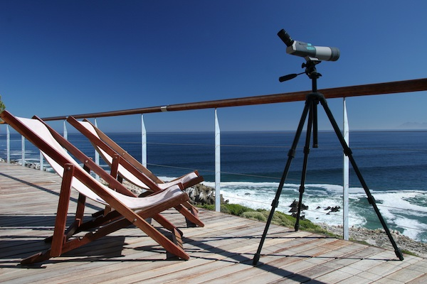 Sunny deck overlooking Walker Bay with a telescope for whale watching