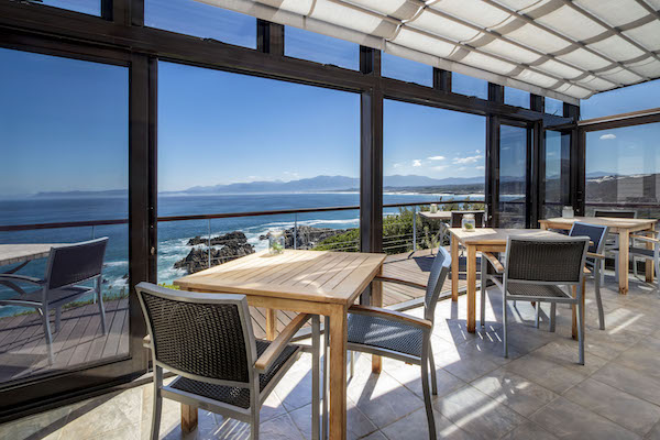 Sunny conservatory with views over Walker Bay