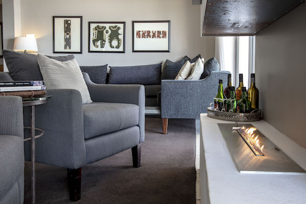 Cosy guest lounge with fireplace at Cliff Lodge De Kelders